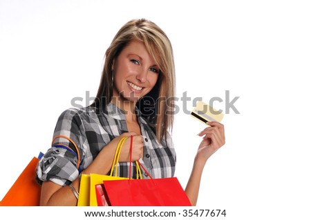 Young woman with shopping bags and credit card isolated on a white background - stock photo