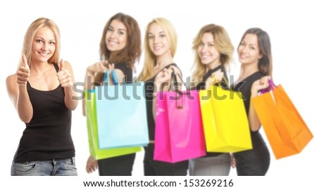 Young woman with shopping bags and thumbs up - stock photo
