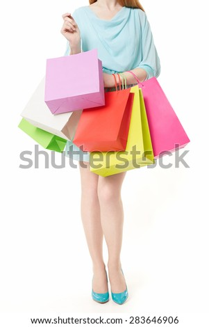 Young woman with shopping bags on white background - stock photo