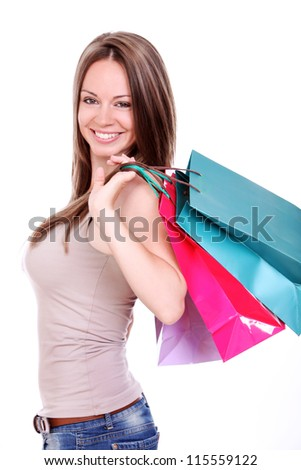 Young woman with shopping bags over white background - stock photo