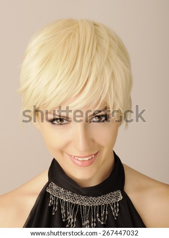 Young woman with short blond hair - stock photo