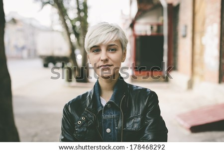 young woman with short blond hair,natural light - stock photo