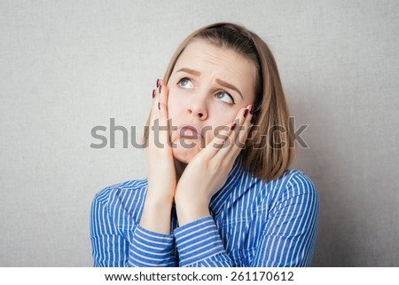 Young woman with sinus pressure pain, isolated on gray background - stock photo