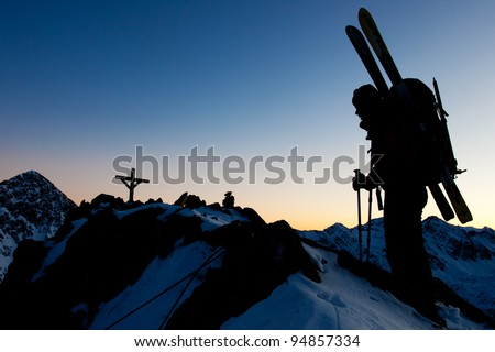 Young woman with ski in winter mountains - stock photo