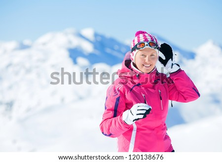Young woman with skis and a ski outfit in the Zillertal Arena, Austria - stock photo