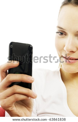 young woman with smart phone on white background studio - stock photo
