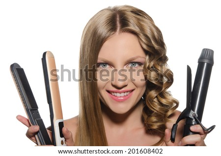 Young woman with  smile holds curling iron - stock photo