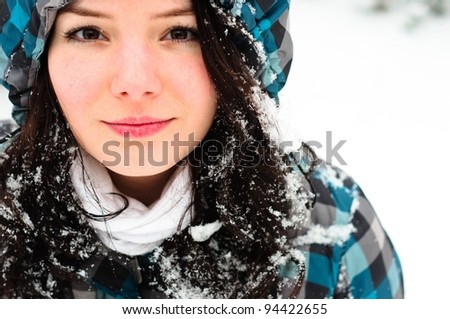Young woman with snow in her hair - stock photo