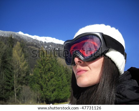 Young woman with snow sunglasses.