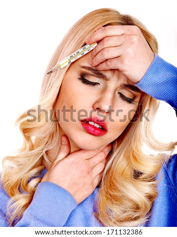 Young woman  with sore throat taking thermometer. - stock photo
