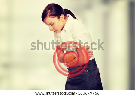 Young woman with stomach issues   - stock photo