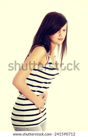 Young woman with stomach issues. - stock photo