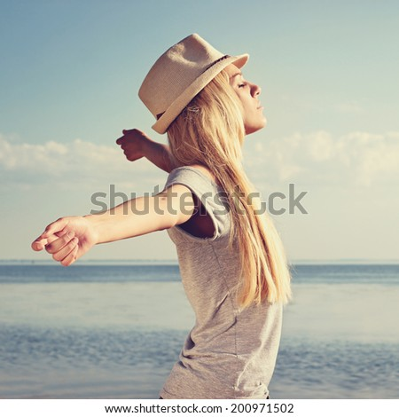 Young woman with stretching arms - stock photo