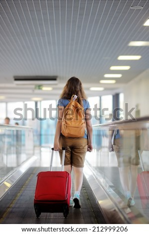 Young woman with suitcase at the airport