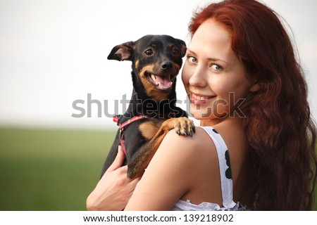 Young woman with sweet dog - stock photo
