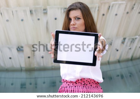 Young Woman with Tablet Out in the City .Girl showing tablet computer - stock photo