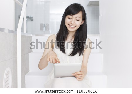 Young woman with tablet pc - stock photo