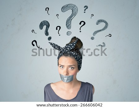 Young woman with taped mouth and question mark symbols around her head  - stock photo