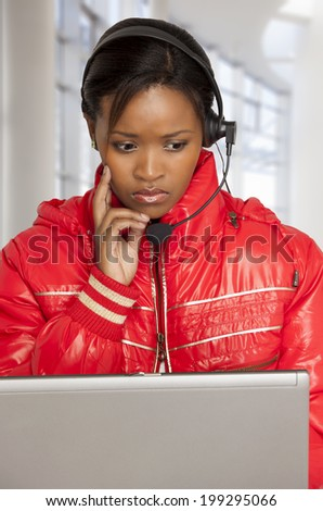 Young woman with telephone headset looking concerned. - stock photo