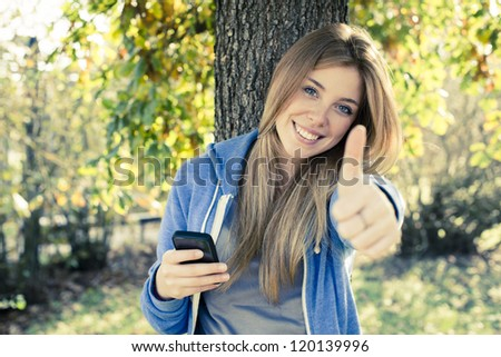 Young woman with thumb up - stock photo