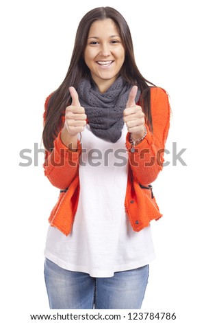 young woman with thumbs up and smiling - stock photo