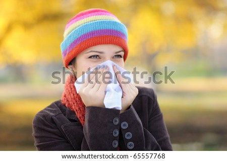Young woman with tissue having flu or allergy - stock photo