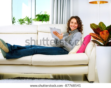 Young Woman With Touchpad At Home - stock photo