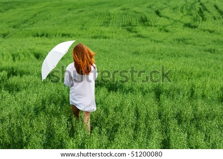 Young woman with umbrella.