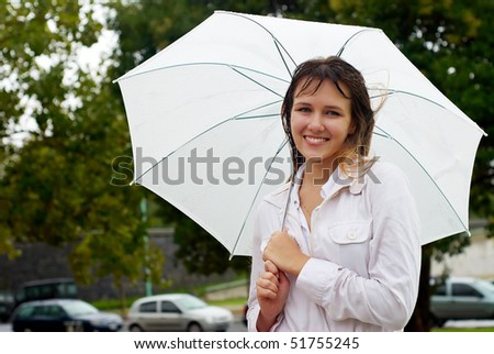 Young woman with umbrella portrait. - stock photo