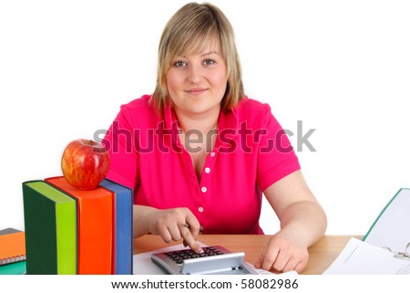 Young woman with using a calculator on white background
