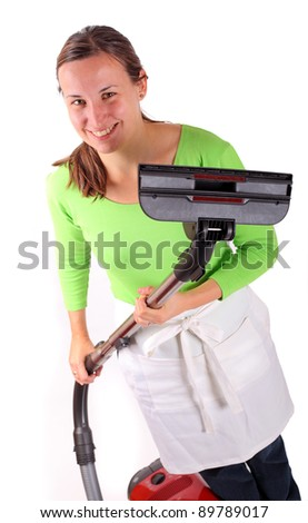 Young woman with vacuum cleaner in hands - stock photo