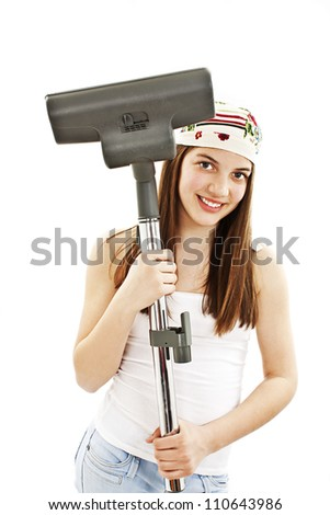 Young woman with vacuum cleaner in hands. Isolated on a white background. - stock photo