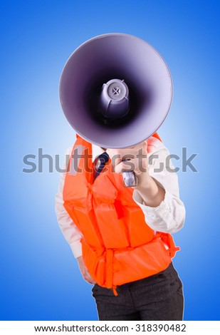 Young woman with vest and loudspeaker on white - stock photo
