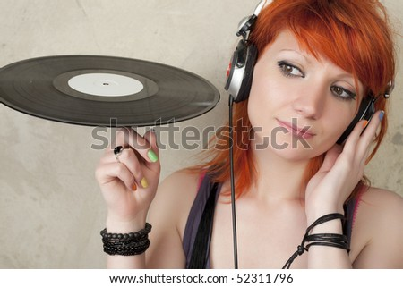 Young woman with vinyl and head phone