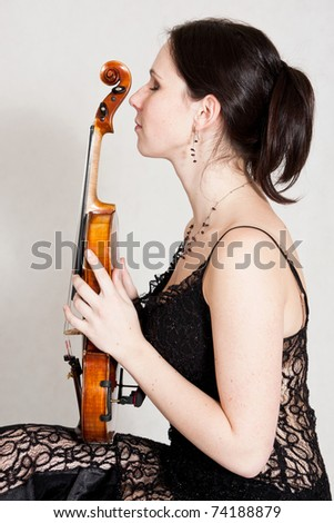 young woman with violin - stock photo