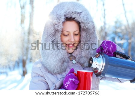 Young woman with warm mug winter portrait. - stock photo