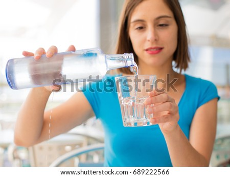 young woman with water drink