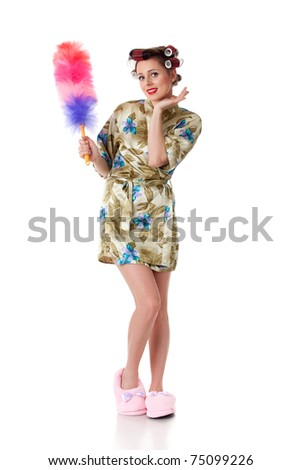 Young woman with whisk on a white background. Housekeeping. - stock photo