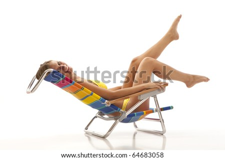 Young woman with yellow bikini lying in beach chair