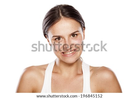 young woman without make-up with a false smile - stock photo