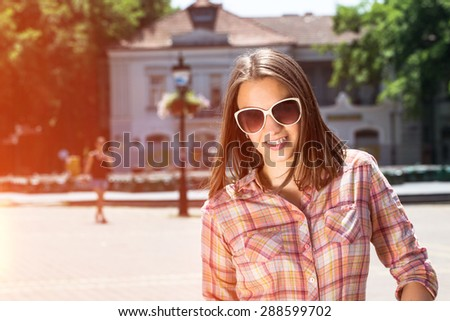 young woman woman with braces on street - stock photo