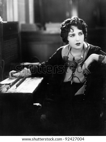 Young woman working as a telephone operator - stock photo