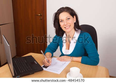 Young woman working at home - stock photo