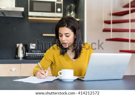Young woman working at home in the morning