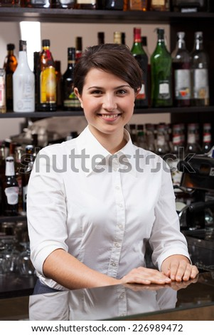 Young woman working at the hotel  bar