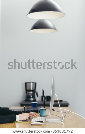 young woman working in a homely office and using her graphic tablet - stock photo