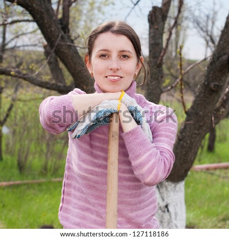 Young woman working in the garden. Garden works. Horticulture - stock photo