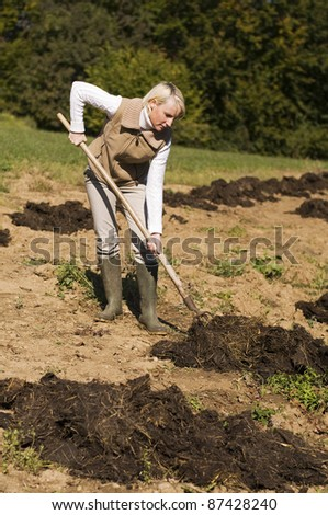 Young woman working on a farm close up shoot - stock photo