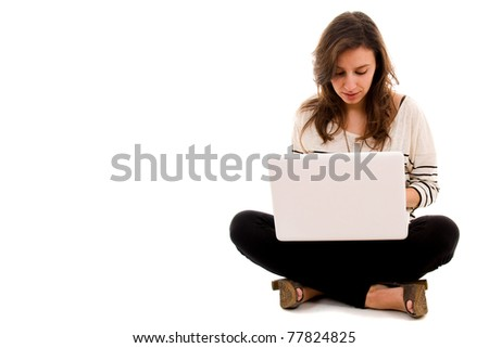 Young woman working on a laptop isolated over a white background - stock photo