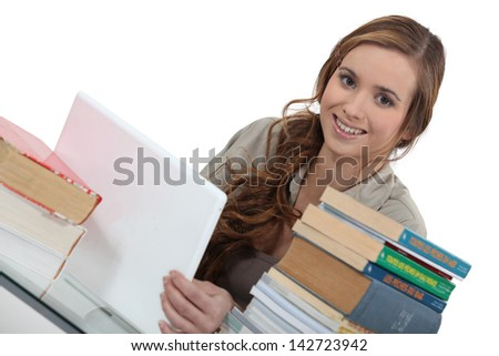 Young woman working on an assignment - stock photo
